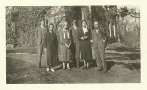 Thumbnail of Library staff standing southeast of ivy covered Old Chapel building