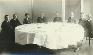 Thumbnail of Faculty members gathered around dining table