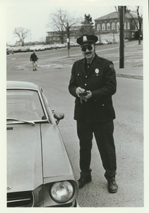Thumbnail of Unidentified police officer writing parking ticket
