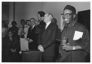 Thumbnail of Chinua Achebe at reception with Joseph Duffey and others
