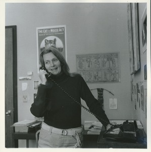 Thumbnail of Joan P. Bean standing indoors, talking on the phone
