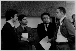 Thumbnail of Randolph W. Bromery standing indoors with Governor Michael Dukakis and two             unidentified men