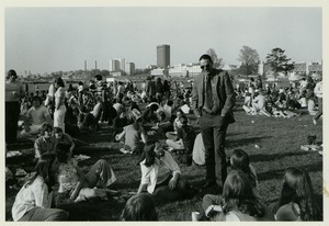 Thumbnail of Randolph W. Bromery conversing with students, outside at student picnic