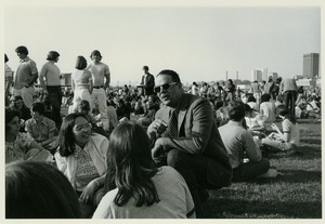 Thumbnail of Randolph W. Bromery conversing with students outside at student picnic