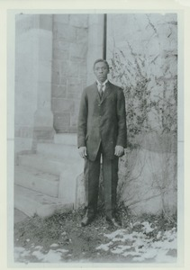 Thumbnail of Matthew Bullock standing outdoors, in front of building