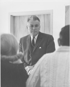 Thumbnail of Bert T. Combs sitting in front of a group.