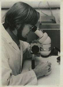 Thumbnail of Henry Howard Hagedorn looking into a microscope