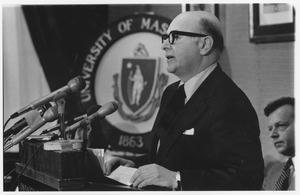 Thumbnail of Henry Koffler speaking from a podium