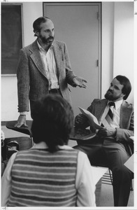 Thumbnail of Richard Leifer standing indoors, talking with man and woman