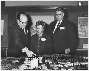 Thumbnail of Edward C. Moore with Ruth Phillips and an unidentified man looking at a scale             model of the Graduate Research Center