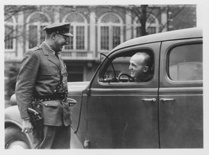 Thumbnail of Campus police officer Tom Moran chats with a unidentified man in car