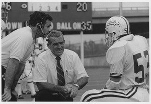 Thumbnail of Bob Pickett and Dick MacPherson talking with unidentified football player