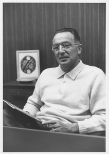 Thumbnail of Edwin Rossman seated, holding publication