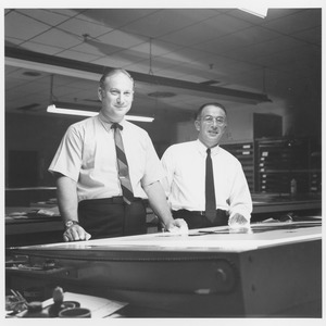 Thumbnail of Edwin Rossman and unidentified man standing at large light table