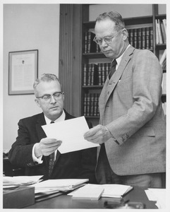 Thumbnail of John W. Lederle and Lamar Soutter examining a paper