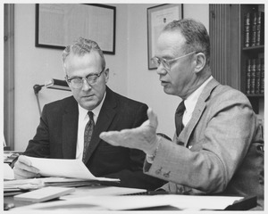 Thumbnail of John W. Lederle and Lamar Soutter discussing a paper
