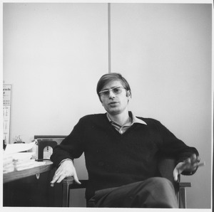 Thumbnail of Paul Theroux seated in an office
