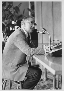 Oswald Tippo speaking at lectern while seated