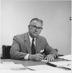 Thumbnail of Oswald Tippo at his desk