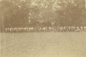 Thumbnail of Class of 1882 lined up on a plowed field
