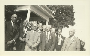 Thumbnail of Members of the class of 1888 pose in front of the home of Mr. and Mrs. Field at a reunion in June, 1938.              Jonathan E. Holt is on the bald man on the left in a dark suit, and Herbert Loomis has a short beard and is in the back row