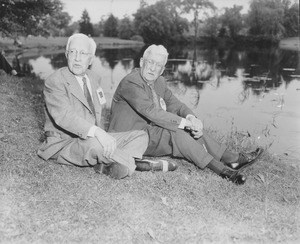 Thumbnail of George Caleb Hubbard and Herbert Warner Dana sitting by the campus pond