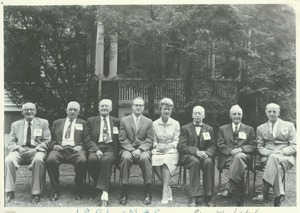 Thumbnail of Members of the class of 1901 sitting outdoors with John and Angie Lederle at             60th reunion