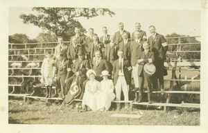 Thumbnail of Members of the class of 1905 and others standing and sitting outside on bleachers