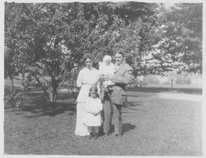 Thumbnail of H. L. Barnes with wife and children standing outside