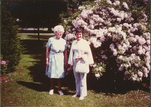 Thumbnail of Grace Hubbard in her yard with Mrs. Laurence Carruth