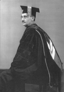 Thumbnail of Earle I. Wilde in cap and gown
