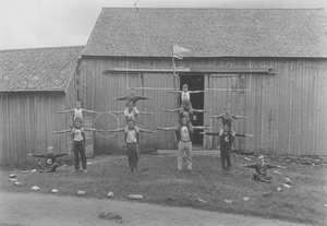 Thumbnail of Men and boys performing at Camp Enajerog
