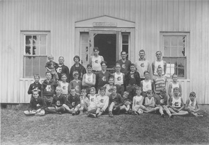 Thumbnail of Campers and counselors gather at Camp Enajerog