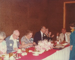 Thumbnail of Clarence Parsons, Ernest McVey and Demetrius Galanie with their wives at reunion dinner