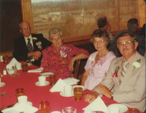 Thumbnail of Charles Clagg and Earl Williams with their wives at reunion dinner