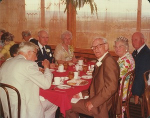 Thumbnail of Roger Cobb, Allan Snyder, Emerson Greenaway and Lewis Whitaker at reunion dinner