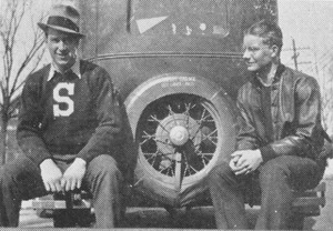 Thumbnail of Unidentified men sitting on car bumper