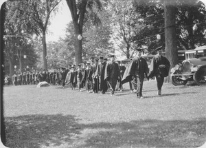 Thumbnail of Graduates parading through campus