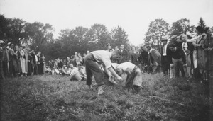 Thumbnail of Students move to anchor their end during the traditional rope pull