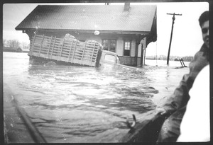 Thumbnail of Flooded farm truck and building