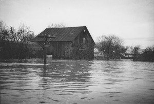 Thumbnail of Flooded farm building and road