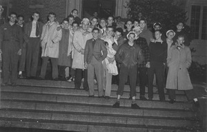 Thumbnail of Class of 1944 members gather on the steps of a campus building