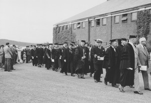 Thumbnail of Faculty and honorary degree recipients in procession past Curry Hicks Cage