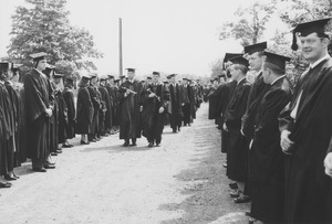 Thumbnail of J. Edgar Parks and unidentified man lead a commencement procession