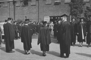 Thumbnail of Graduates form a path into Curry Hicks Cage