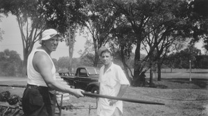 Thumbnail of Warren McGuirk and Richard M. Brown at barbecue pit, summer session barbecue