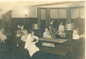 Thumbnail of Class of 1923 women relaxing indoors