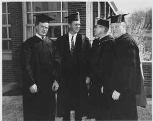 Thumbnail of Charter Day: Gordon Oakes, Governor Endicott Peabody, President John W. Lederle, and Bishop Christopher J. Weldon outside Totman Gymnasium