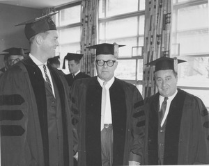 Thumbnail of Charter Day: Governor Endicott Peabody, honoree George Meany, and John E. Powers inside Totman Gymnasium