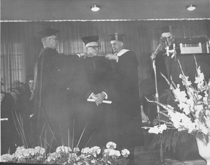 Thumbnail of George Meany at his hooding ceremony during the Centennial Charter Day convocation